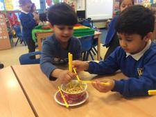 We have been learning about Chinese New Year today, finding out about how noodles change when they are cooked, and using chopsticks. We added them to our water tray, too. 2