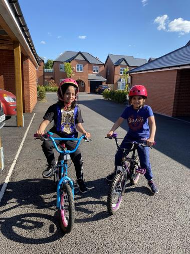 Ayah and Nisa enjoying a bike ride