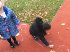 After sharing the story of Elmer the elephant, we drew our own colourful squares outside. 3