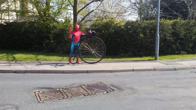 Spiderman on a Penny-Farthing