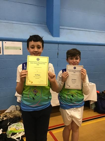 George  and Kenzo  sharing their certificates