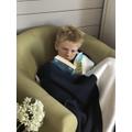 Josh has found a cosy reading spot!