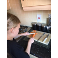 Chloe showing us her cooking skills!