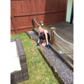 Chloe being super helpful and gardening.