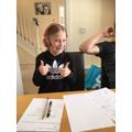 Chloe is wearing headphone - just like dad!