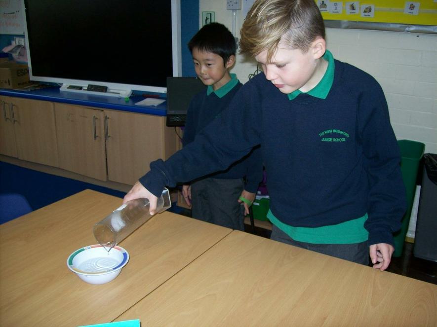 Refracting light through water.