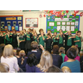 Year Six teach a silly song to the audience