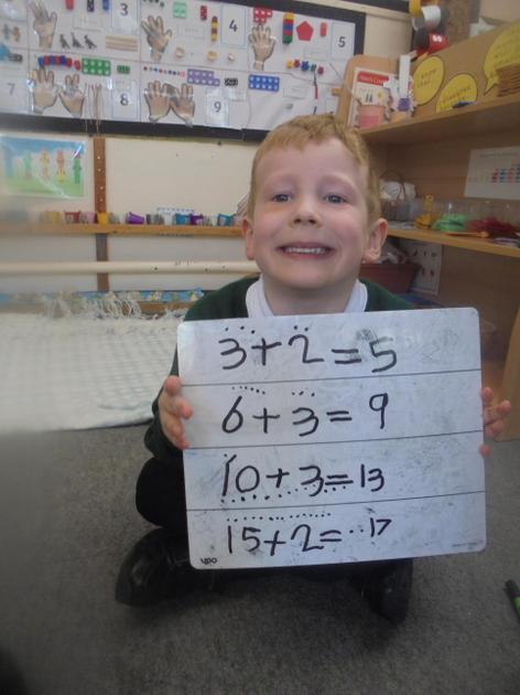 One very happy boy after he completed his number problems.