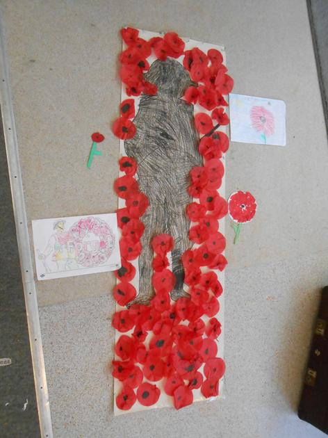 We created the Poppies growing around the Soldiers after reading Flanders Field