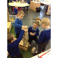 Great team work building a tower.
