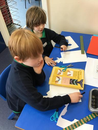 The children found a fantastic book about making a whale bookmark - so we had a go!