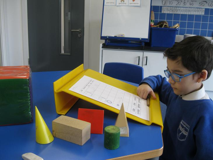 Exploring 3D shapes with objects.