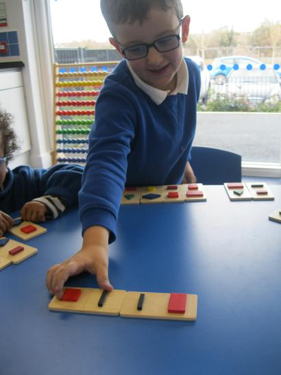 Exploring shapes with dominoes.
