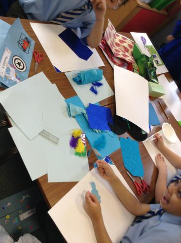 Year 4 collaging their background.