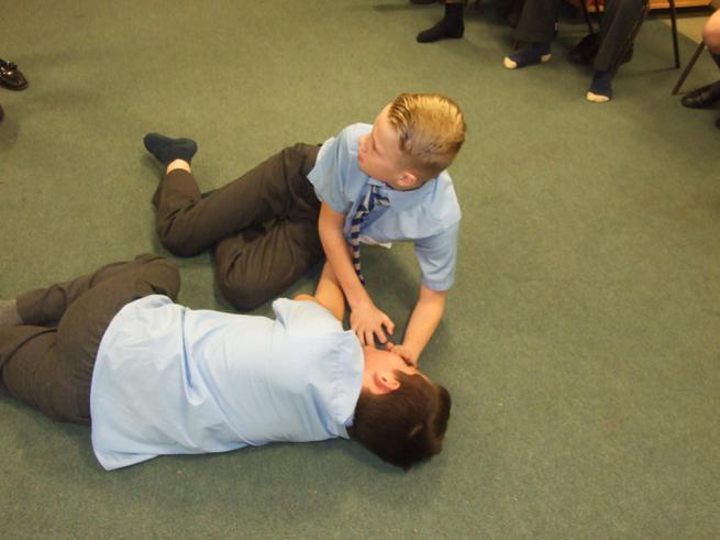 Practicing the recovery position.