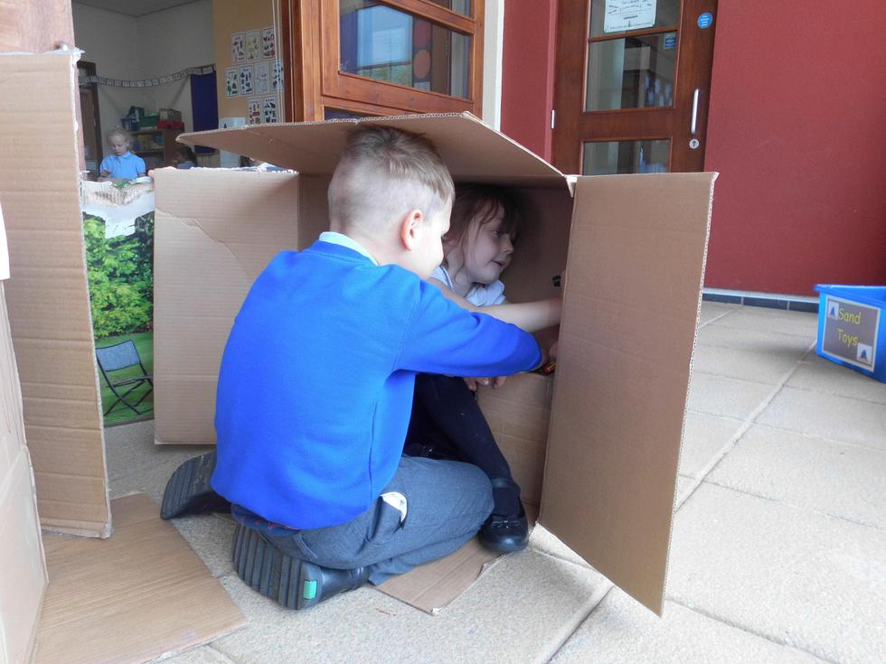 Den building with the cardboard boxes.