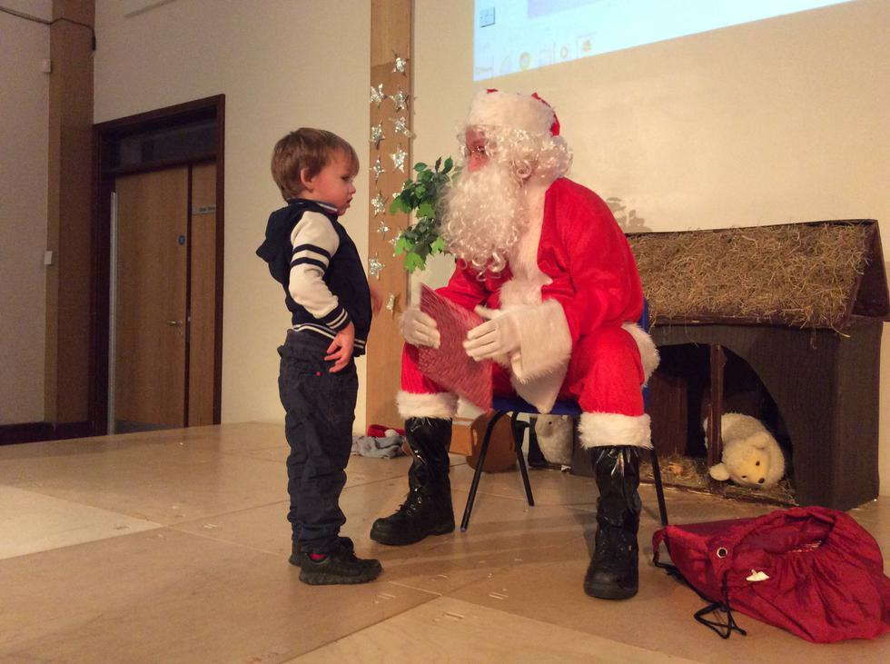 We learn about different celebrations. This is Santa at the Christmas party. He brought us presents. (2).JPG