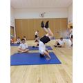 Aaron's headstand in Gymnastics.