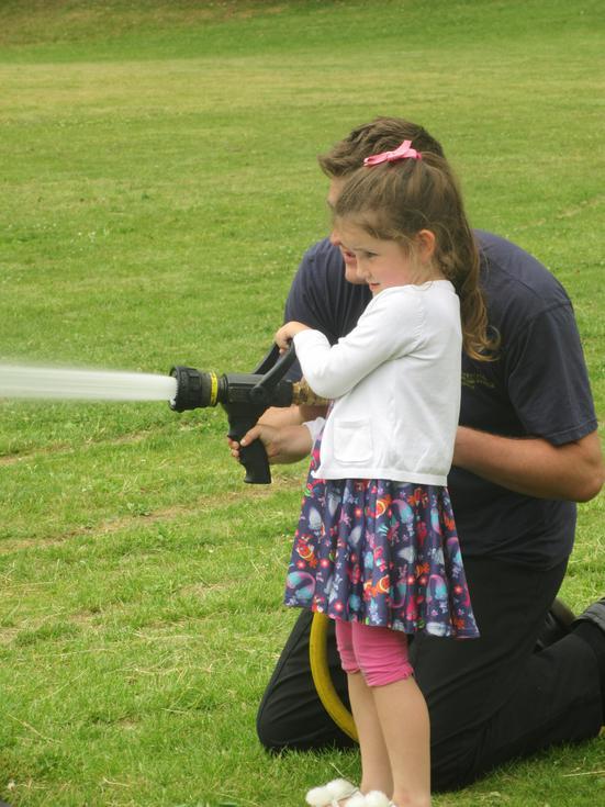 Darcie had a turn spraying the hose!.JPG