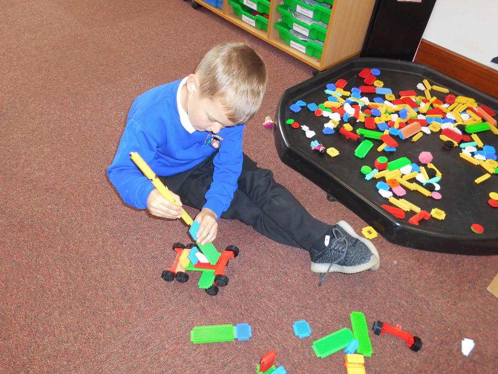 Making cars with the stickle bricks.