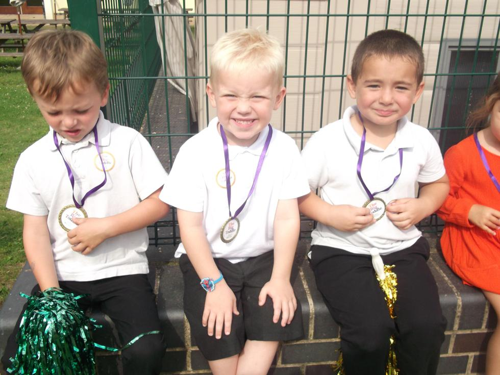 Matthew, Joshua and Rhys are so proud of their medals.JPG