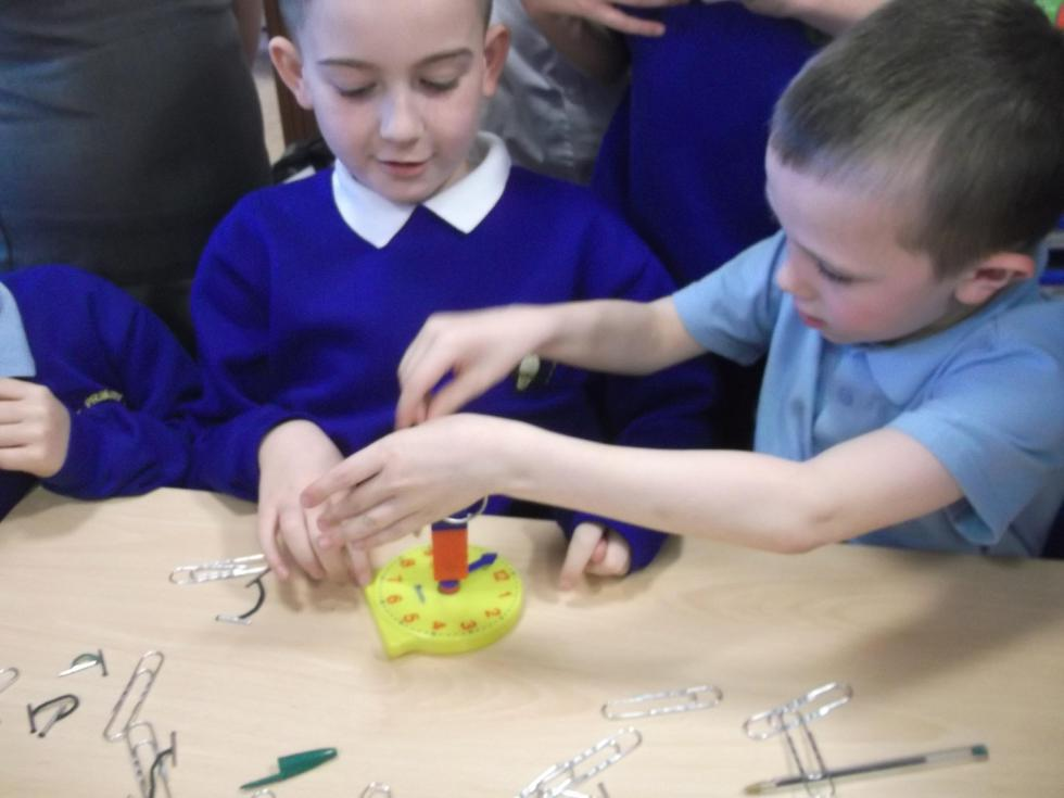 Which parts of a plastic clock could be magnetic?