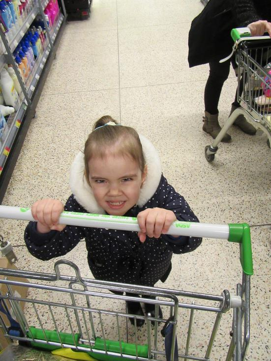 Olivia pushing the trolley