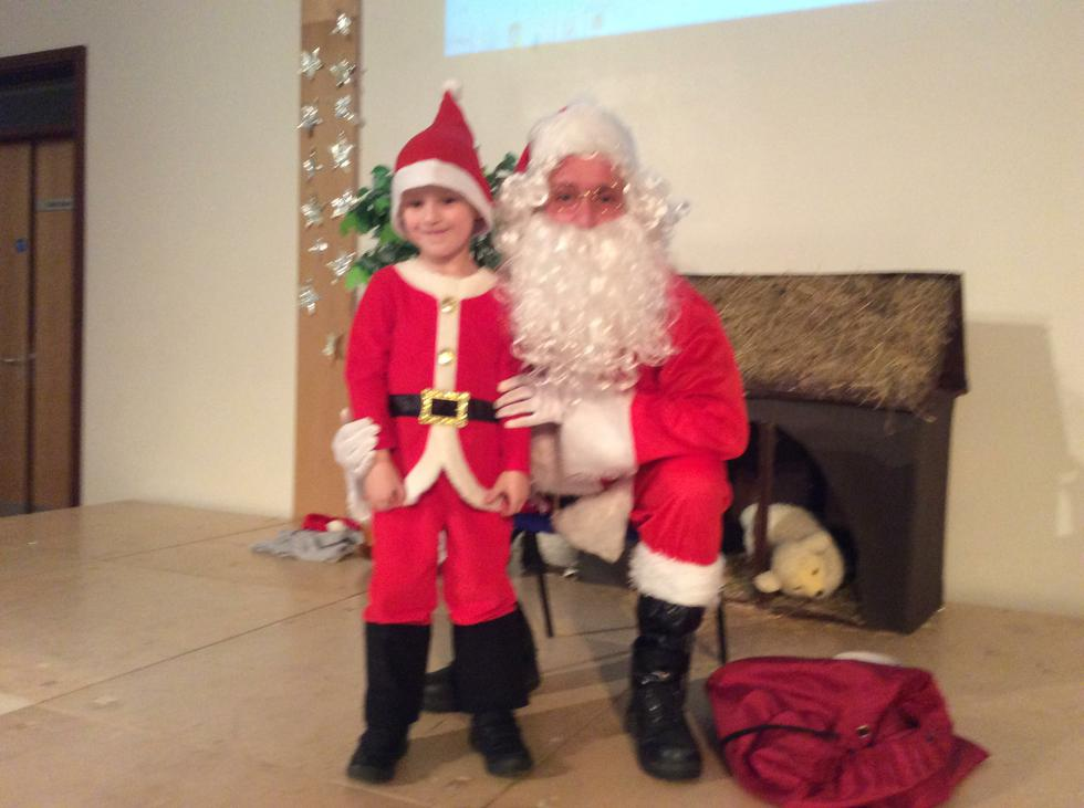 We learn about different celebrations. This is Santa at the Christmas party. He brought us presents..JPG