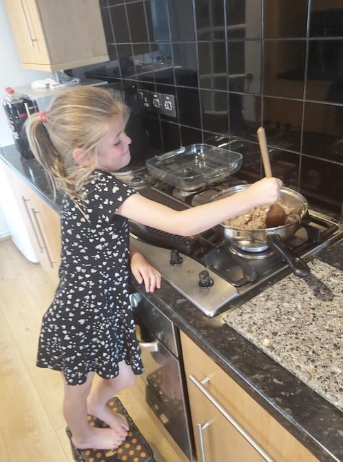 Being very helpful making dinner!