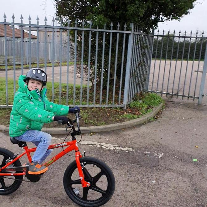 Getting some fresh air on his new bike!