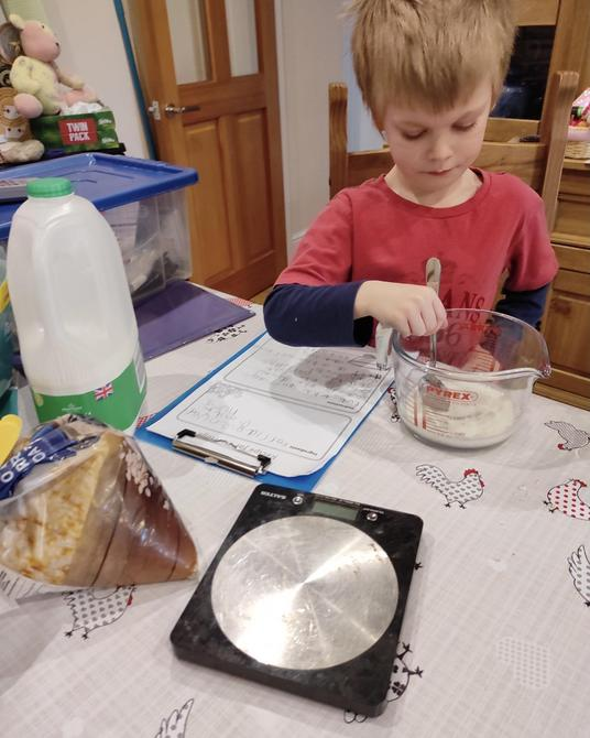 Following his instructions to make the porridge!