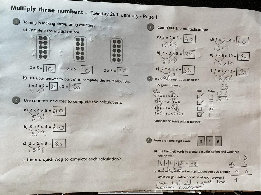 Multiplying 3 numbers by Sienna - look at all these jottings to help - Amazing!