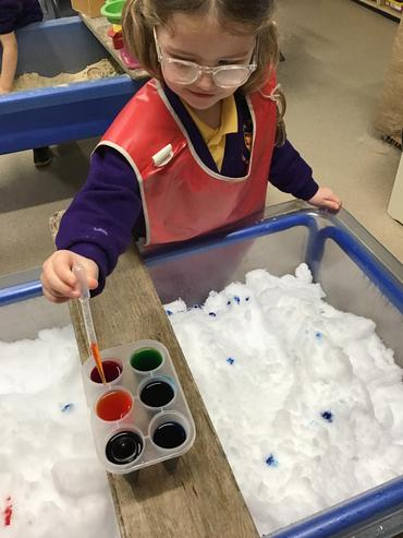 What better way to explore colour mixing than with snow, coloured liquid and a pipette!