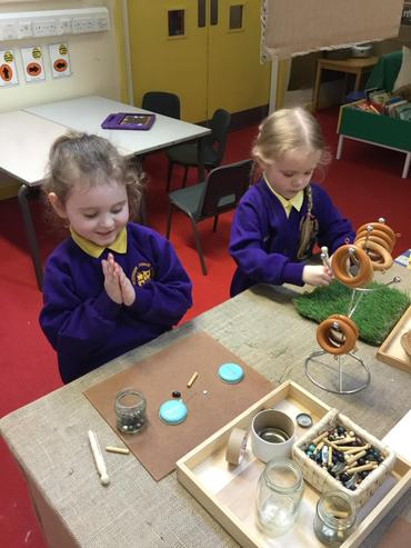 Busy exploring our new 'Loose Parts' station.
