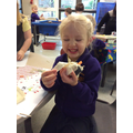 A very proud play dough snowman builder