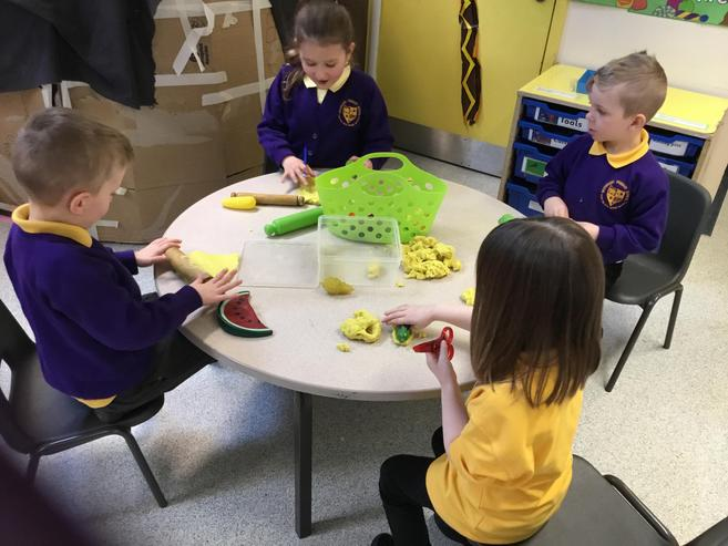 Moulding and carving the 'fruit' playdough