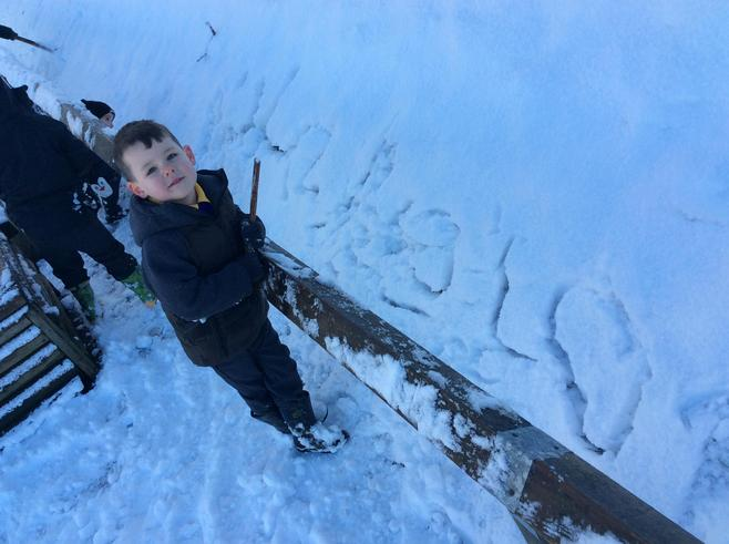 Writing in the snow with sticks!