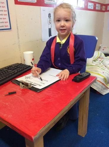 Practising our writing as a receptionist.