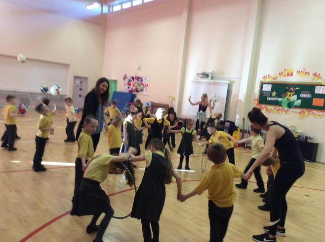 Working as a team to pass the hula hoop