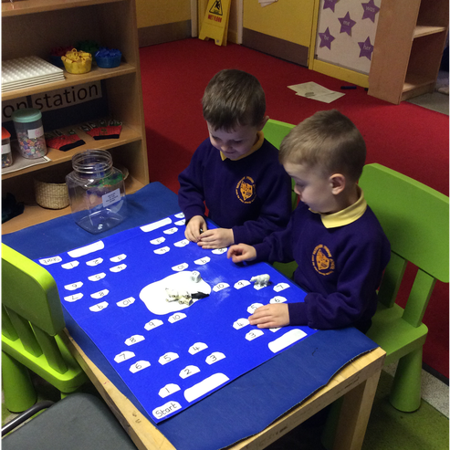 Friends enjoying playing our arctic number game.