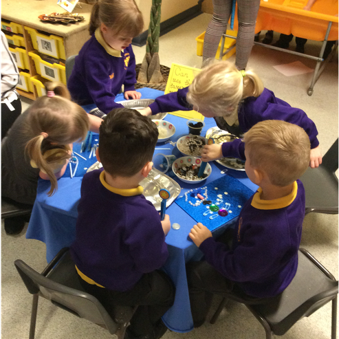 Creating pictures with our sparkly treasure finds!