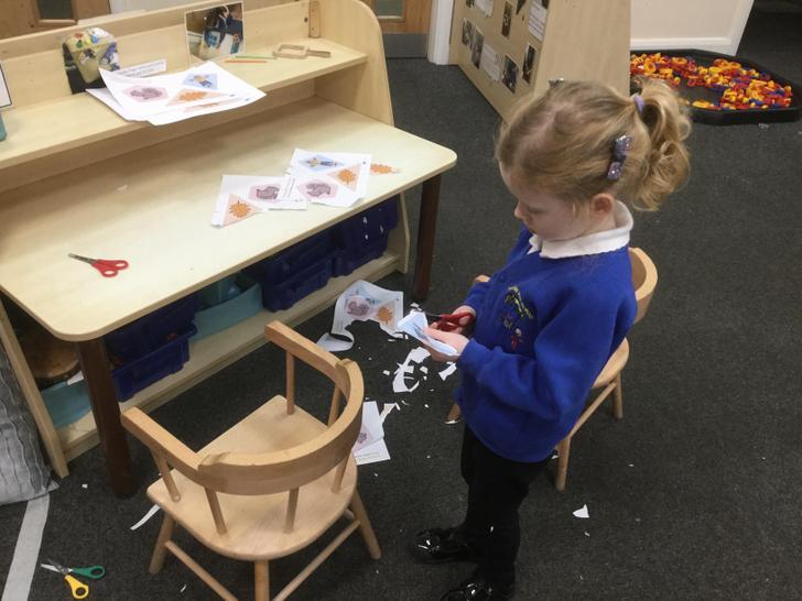 Practising scissor skills to cut the shapes