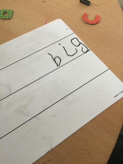 Joseph used his fred fingers to write the word big