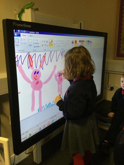 Drawing  pictures on the whiteboard