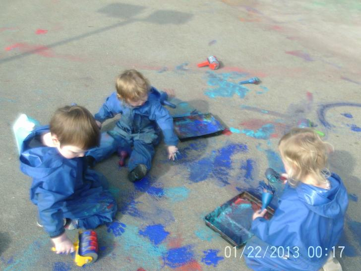 We used rollers to paint outside!