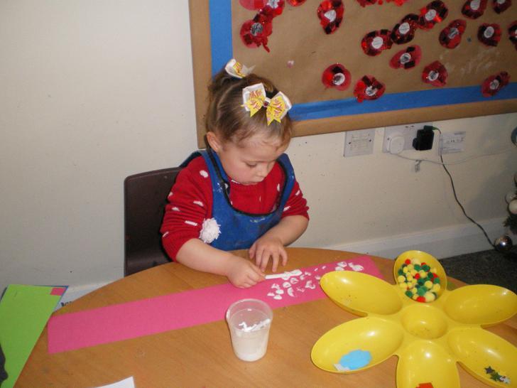 Ella-Mae making her party hat