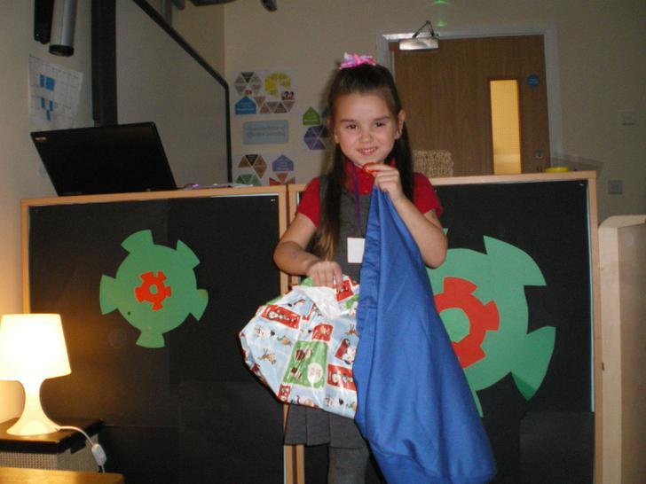 Charlotte packs her parcel for Santa
