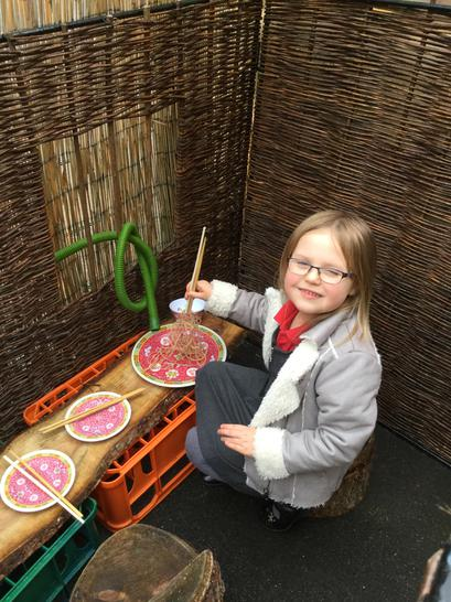 Playing in our Chinese restaurant role play area