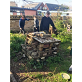 Our minibeast home being improved with new sticks and rocks