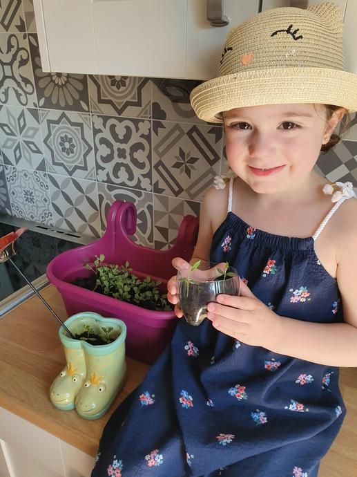 Eliza growing seeds!